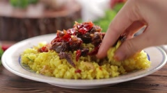 Hot and spicy beef with saffron and turmeric rice eating by hand Stock Footage