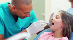 Male dental surgeon examining a little girl Stock Footage