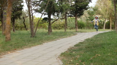 A boy is running on pathway Stock Footage