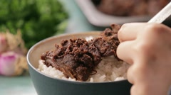 Jerky beef stew on white rice in a bowl Stock Footage