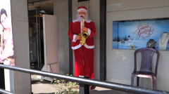 Santa Claus came in tropical India, dancing and playing the saxophone Stock Footage