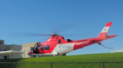 Medical flight helicopter sky ambulance starting up at hospital Stock Footage