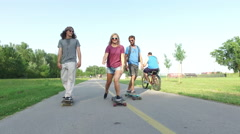Blonde woman longboarding with friends Stock Footage