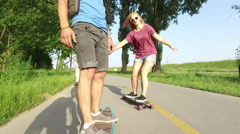 Close view of man longboarding with friends Stock Footage