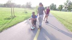 Happy friends longboarding on a beautiful summer day Stock Footage