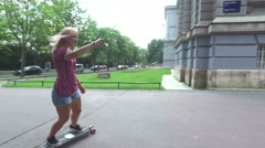 Back view of female longboarder in the city Stock Footage