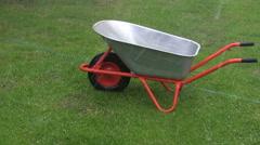 Hail and rain falling on wheelbarrow Stock Footage