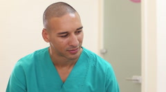 Close up of male dental surgeon talking with patient Stock Footage