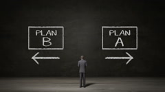 Businessman choose Plan A or Plan B. decided ways. makes decision. Stock Footage
