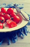 Cherry tomatoes with water droplets Stock Photos