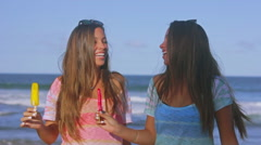 Authentic Twin Sisters Laughing With Melting Popsicles At The Beach Slow Motion Stock Footage