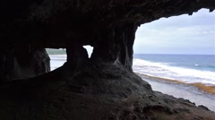 Ocean viewpoint from coastal cavern Rurutu pan Stock Footage