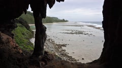The sea shore seen from a cavern in coastal cliff Stock Footage