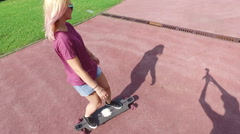 Close back view of female longboarder in the city Stock Footage