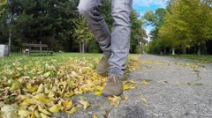 Man Walking in the Autumn Park on a Sunny Day - slow motion Stock Footage