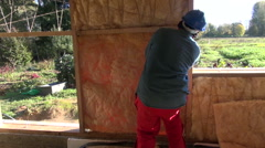 Builder insulating house with mineral wool Stock Footage