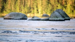Streaming river with soft focus stones in the background Stock Footage