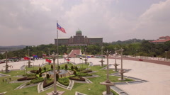 Flying past flags to Presidential Palace Putrajaya Stock Footage
