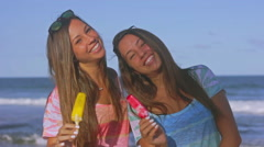 Twin Sisters And Melting Popsicles In A Hot Summer Day At The Beach Slow Motion Stock Footage