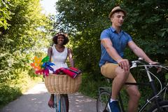 Young multiethnic couple having a bike ride in nature Stock Photos