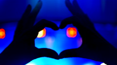 4K Music Crowd Hand Shaped Hearts, Blue Lights and Happy People, Silhouette Stock Footage