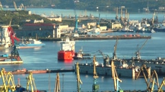 Tugs pushing large ship to the dock. Stock Footage