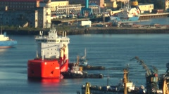 Tugs pushing slowly large ship to the dock. Stock Footage