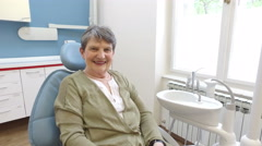 Close up of happy elderly female patient at dentist Stock Footage