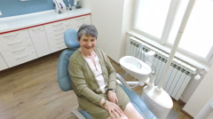 Elderly woman sitting in the dental chair Stock Footage