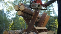 Saw dust flying in slow motion cutting logs with a chainsaw Stock Footage