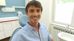 Close up of smiling man with healthy white teeth at dentist Stock Footage