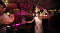 Bride and groom are dancing at the wedding party Stock Footage