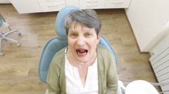 Close up of an open mouth of an elderly woman at dentist Stock Footage