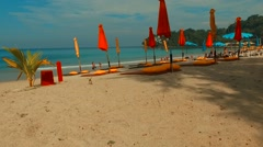 Flight through the beach umbrellas. Phuket. Thailand. Stock Footage