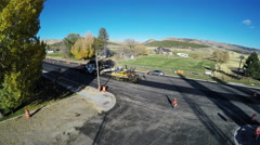 Aerial-Road construction in small rural Utah town. Stock Footage