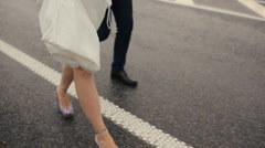 Legs of bride and groom close up at the rain Stock Footage