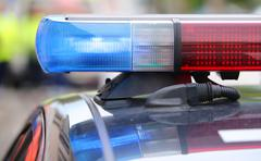 Red and blue flashing lights on the police car during the reconnaissance in t Stock Photos