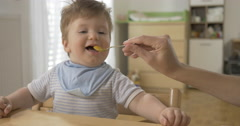 Beautiful Baby Eating Baby Food Stock Footage