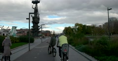 "The walk along the embankment  on a Bicycle, a sculpture of ""Peter the great"" Stock Footage"