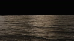 Ocean surface loop with alpha, isolated on black, soft evening sunset light Stock Footage