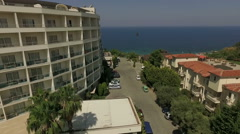 Aerial view of the hotel Amara Sealight Resort with the sea on the background Stock Footage