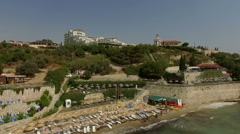 People at the beach near the hotel in Turkey's resort Stock Footage