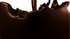 Turbulent liquid chocolate filling the frame Stock Footage