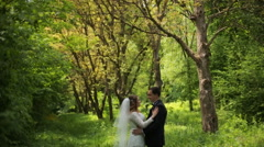 Bride Walks in the Woods , Sunset and Forest. Beautiful Couple on a Sunny Day Stock Footage