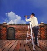 Business man and single spying telescope lens looking for target concept Stock Photos