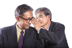 Two asian senior business man gossip for business strategy isolated white bac Stock Photos