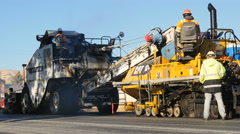 Asphalt paving machine working road construction Stock Footage