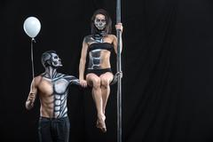 Couple of dancers with body-art and balloon Stock Photos
