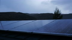 Rolling storm clouds over solar panels on a roof. Stock Footage