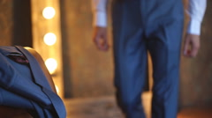 The groom takes his jacket from the chair Stock Footage